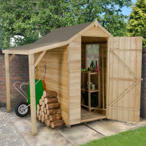 a small wooden shed with single door and lean-to shelter on the left hand side, housing logs and a green wheelbarrow