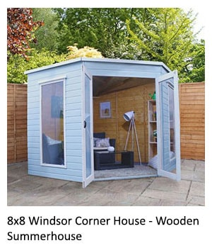 An 8x8, blue corner summerhouse with pent roof, 2 full-length windows and glazed double doors