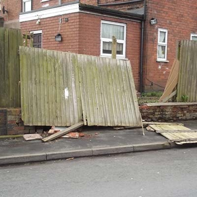 Storm damage to a fence